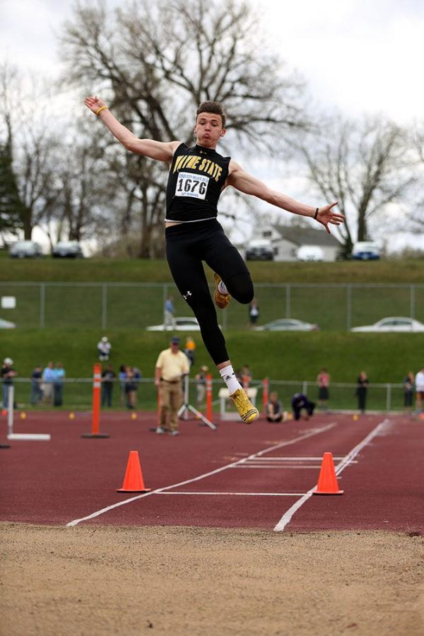 Brady Metz places fifth in long jump during the Souix City Relays. Metz also placed first in triple jump, making him one of three Wildcats with top finishes for the weekend.