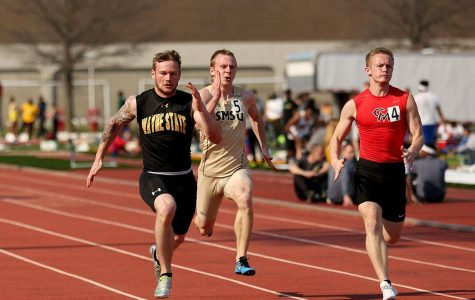 Clay Kramper reaches a new personal best in the 100 meter dash on Saturday in Emporia.