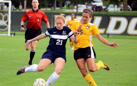 Sophomore Carys Hund defends against the Vikings at the first home game of the season last Friday. Hund was the only Wildcat to score a goal in the contest to tie against top ranked Augustana University 1-1, giving the Wildcats a 3-0-1 record for the year.