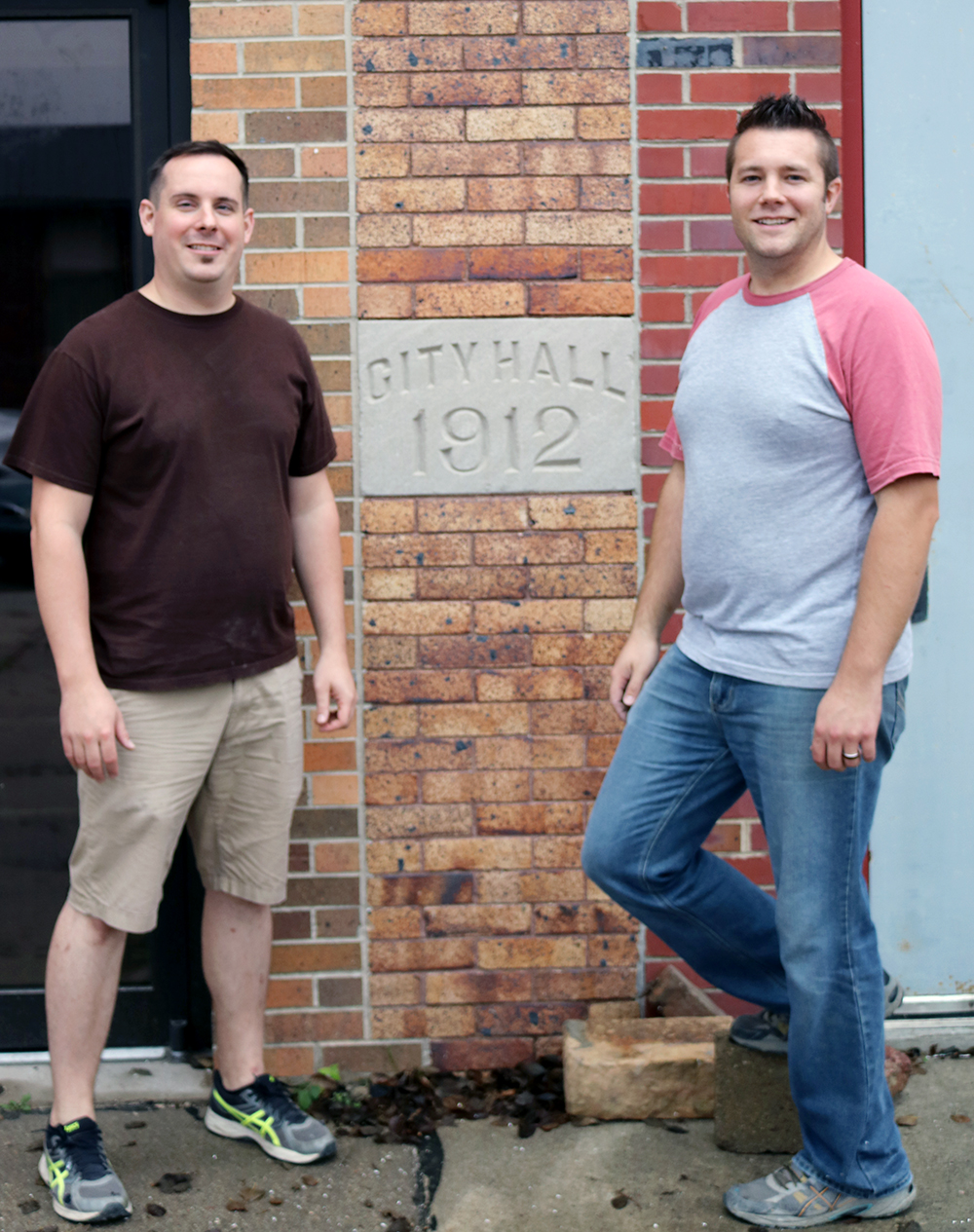 Owners Mark Kanitz and Lukas Rix stand in front of the old 1912 Building. A part of the building is being leased out to Bryce Allen to start up a brewery for craft beer.