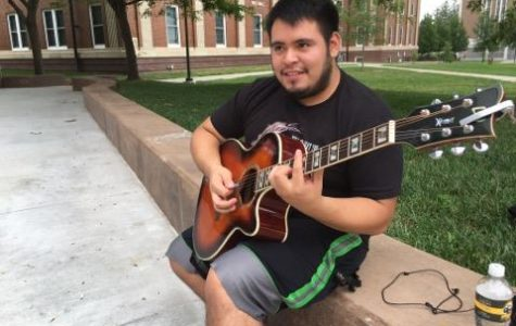 Senior Henry Ventura likes to play his guitar outside of Conn Library to build confidence playing in public and in hopes of finding people with the same interests in music.