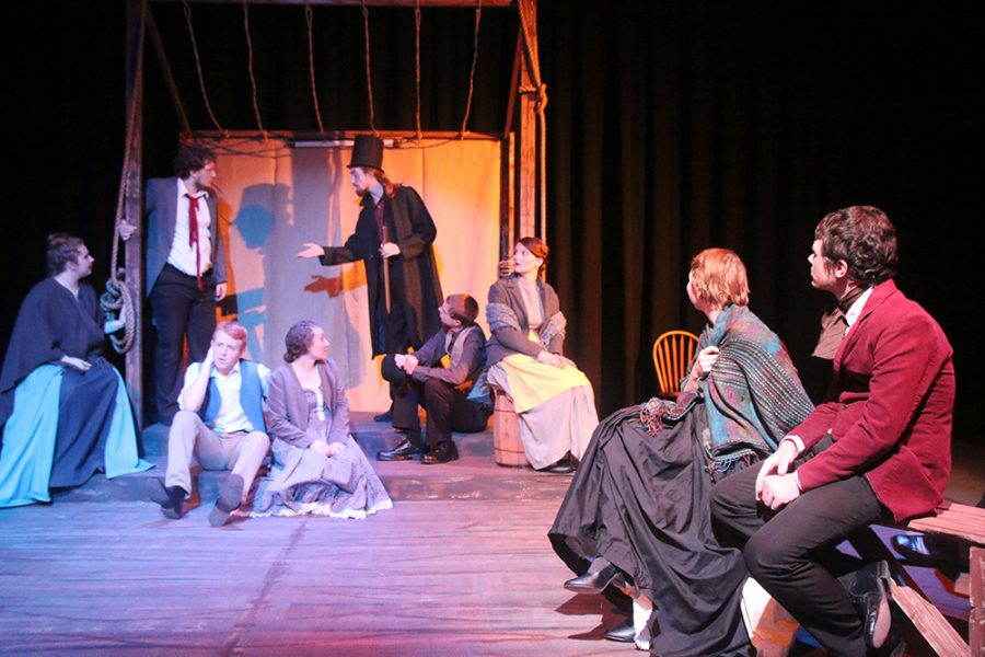 """The acting troupe listens to a story told by Abe (Dakota Schroll) while resting. """"How Shakespeare Won the West"""" opens Thursday night at 7 in the Black Box Theatre. It runs through Sunday."""
