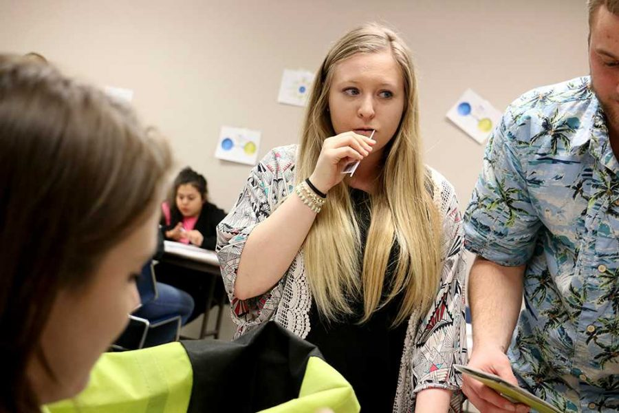 WSC student Lily Roberts swabs her mouth in order to join the National Bone Marrow registry in the Bluestem Room last Friday.