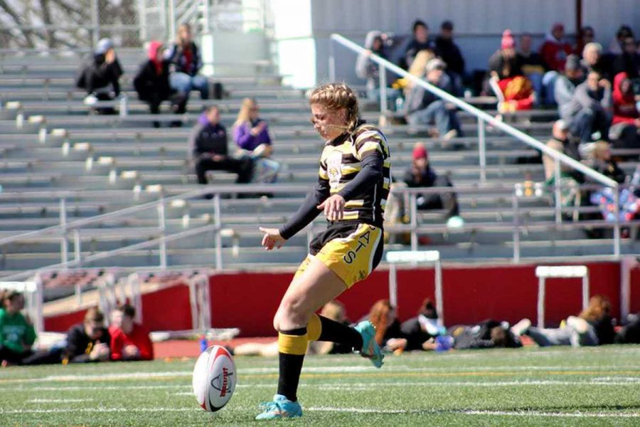 Kelcey+Stutzman+kicks+a+field+goal+for+extra+points+after+the+team+scores+a+try+in+the+opening+weekend+for+the+spring+season.+The+women%E2%80%99s+club+won+all+three+of+its+games%2C+while+the+men+took+home+three+losses.