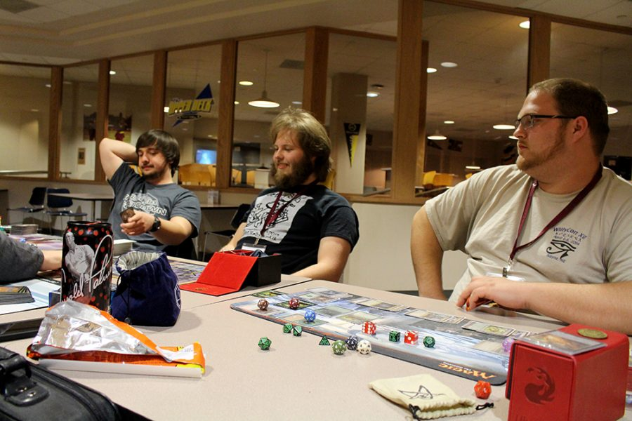 Alumni join students at WillyCon to play Magic the Gathering. Left to right: Patrick Hancock, Michael Vacha and Gabriel Flanagan.