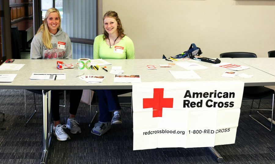 Macy+Grotelueschen+and+Hannah+Lauer+volunteer+at+the+sign-in+table+for+the+Red+Cross+blood+drive.+Wayne+State+College+hosts+the+drive+giving+students+and+faculty+the+opportunity+to+save+lives+without+having+to+leave+campus.+One+pint+of+donated+blood+can+save+up+to+three+lives.