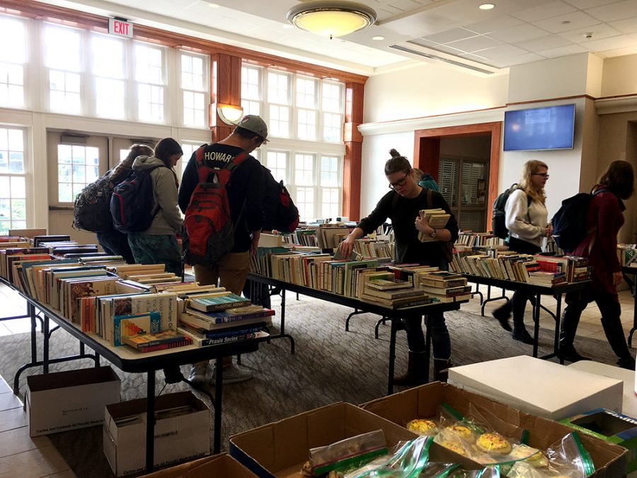 Students+helped+Pi+Gamma+Mu+with+the+sale+of+books+and+baked+goods.+The+book+and+bake+sale+took+place+in+the+lobby+of+Connell+Hall.
