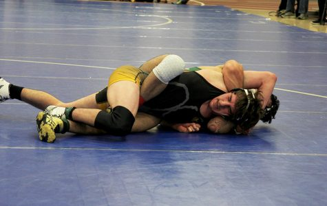 Wrestling team experiences struggles in latest meet