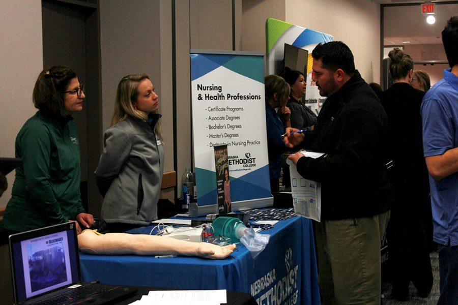 Nebraska Methodist College Representatives talk with student Angel Gonzalez at the WSC career fair.