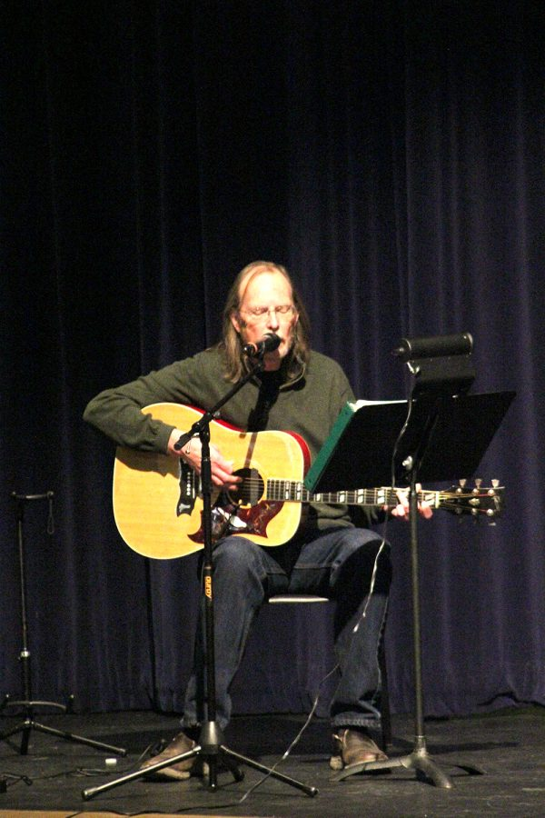 Eddie Elfers played guitar and Hannah Knoxx spoke at Dr. Cooper's memorial service on Sunday.