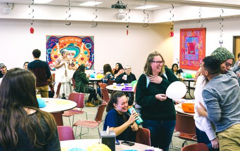 Students learn about Dia De Los Muertos with food and entertainment