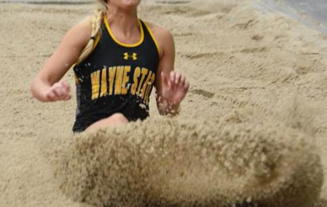 Riana Noelle jumps into the pit during the long jump.