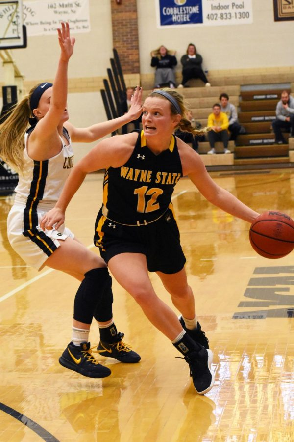 Senior Maggie Lowe dribbles by her defender in the win over Concordia St. Paul.