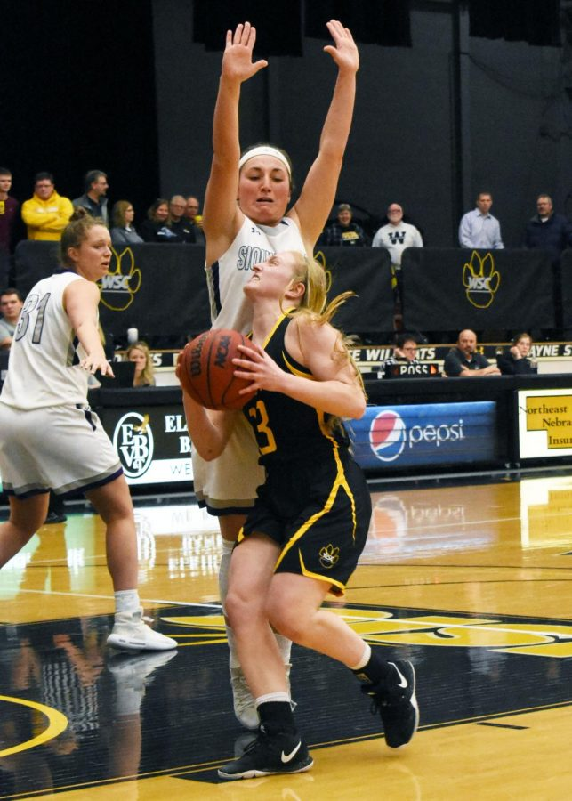Halle Busse drives in for a layup against a University of Sioux Falls defender.