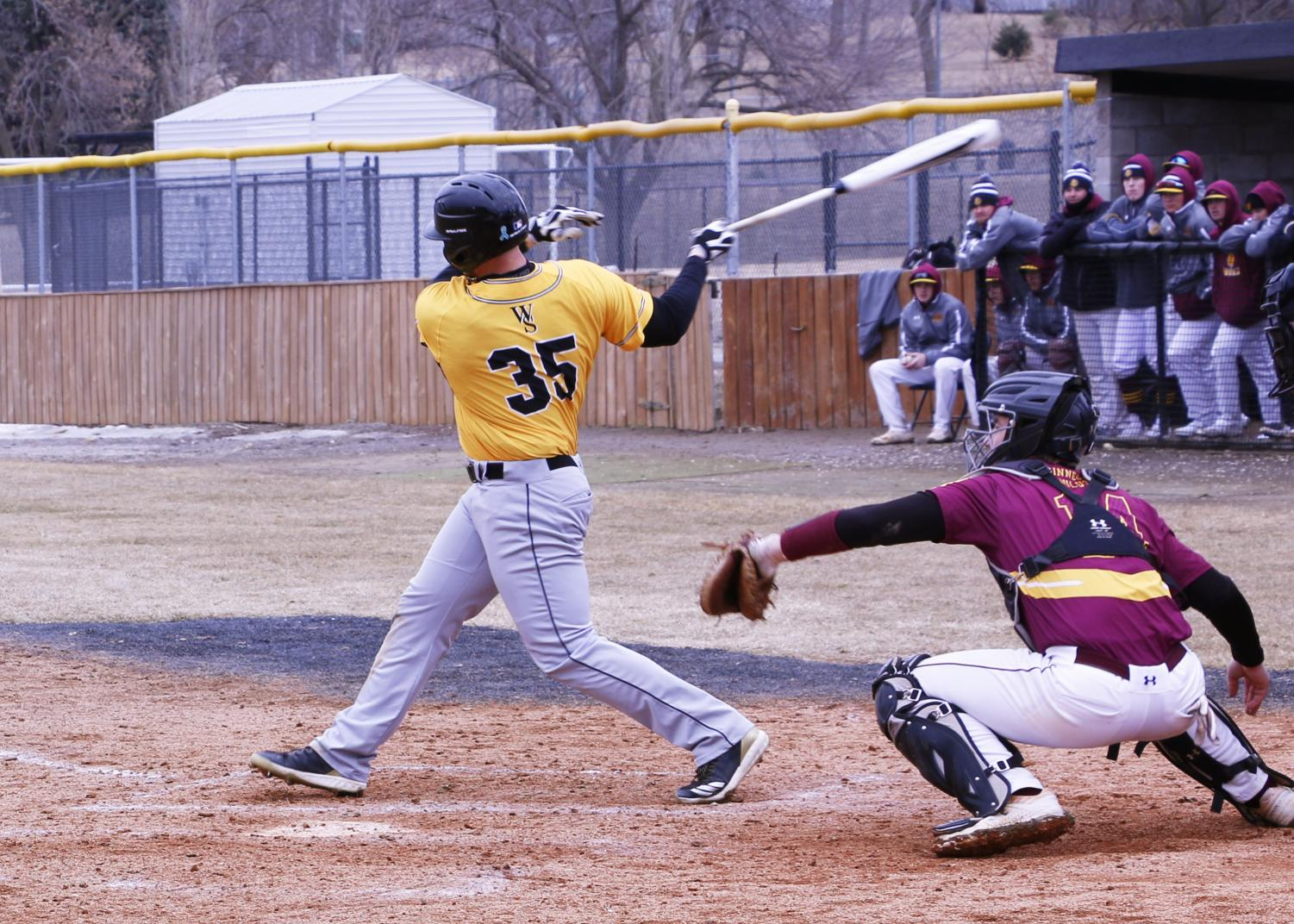 Junior Bryce Bisenius makes contact with a pitch against the Minnesota Duluth Bulldogs on Saturday.