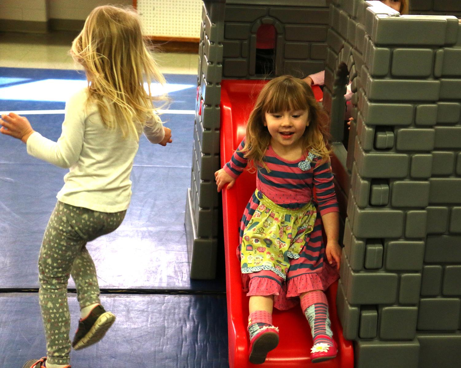Two children enrolled in WSC's Kiddie College preschool enjoy the new early childhood indoor activity area which opened on March 26 as part of the Nature Explore program.