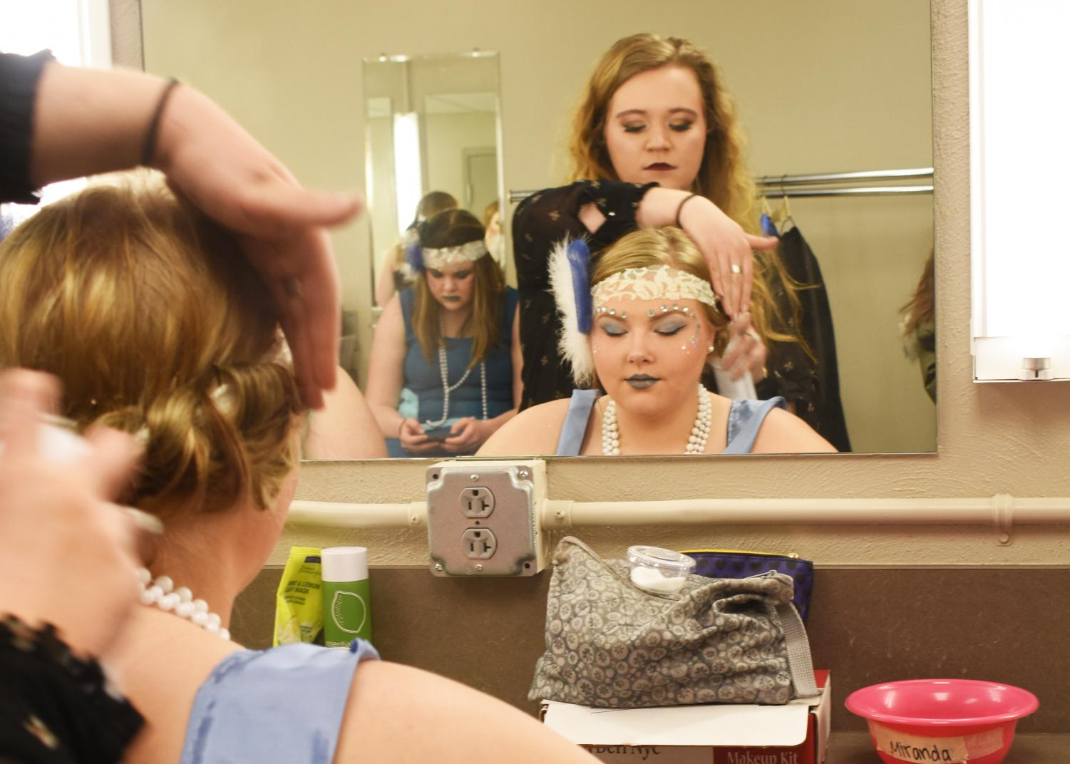 "Members of the production of ""A Midsummer Night's Dream"" prepare backstage prior to a performance of the play last week. Baxter was impressed with the detail of the production's costuming."