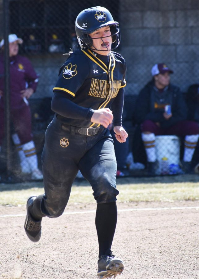Senior+outfielder+Morgan+Vasa+takes+off+for+first+base+in+the+Monday+morning+game+against+NSIC+opponent+St.+Cloud+State.+Vasa+currently+has+a+.310+batting+average+through+the+first+23+games+of+the+season+for+the+Wildcats.+Vasa+has+recorded+18+hits+in+her+58+at+bats+so+far.+She+is+optimistic+that+the+team+will+improve+throughout+the+rest+of+the+season.