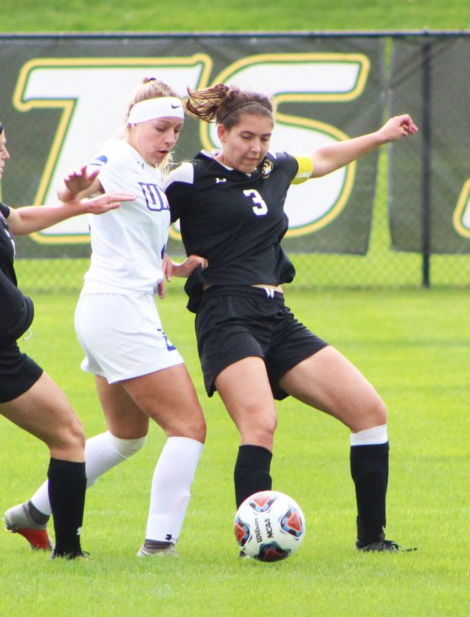 Madison Burgard steals the ball from her opponent in a defensive move