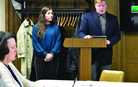 Senior Adam Smith, with the support of junior Kori Siebert, presents on behalf of the Civic Leadership at Wayne State (CLAWS) club to the city council.