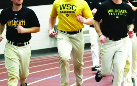 WSC baseball players participate in warmup laps at the beginning of practice.