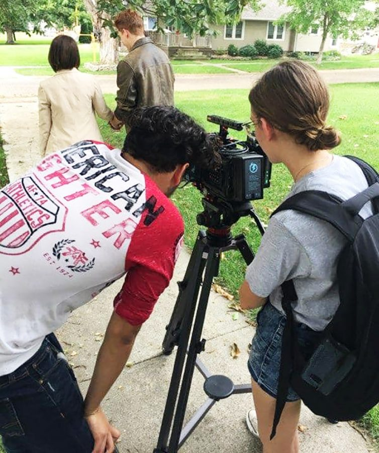 Director Ally Boyd films students on the set of The Offer. The film was written also and produced by Shelby Hagerdon. Dr. Mike White forsees the students as they work on their short films.