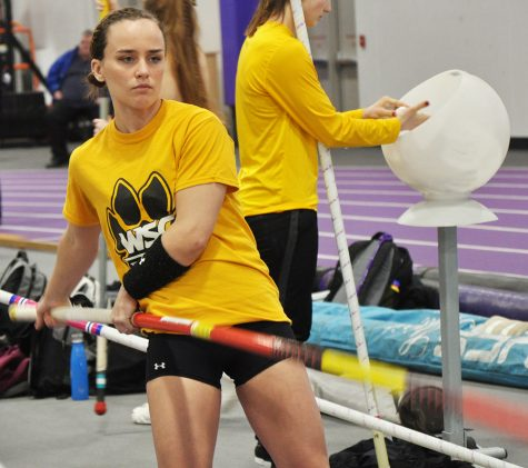 Mikayla Marvin prepares for a run through of pole vault.