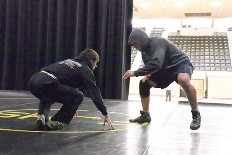 Weiss, left, and Cisneros, right, practice before nationals.