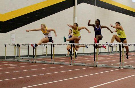 Megan Hansen in the hurdles at a recent WSC home meet.