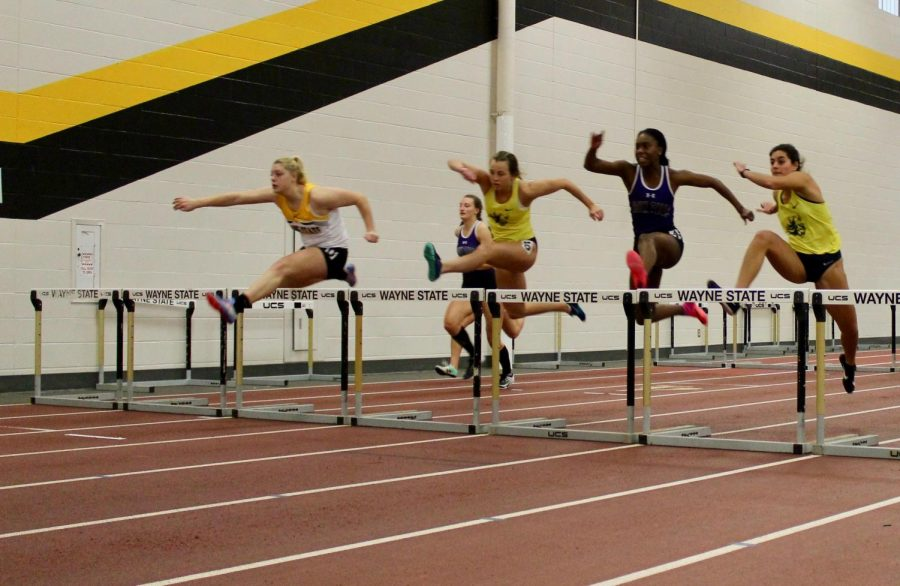 Megan Hansen in the hurdles at a recent WSC home meet.