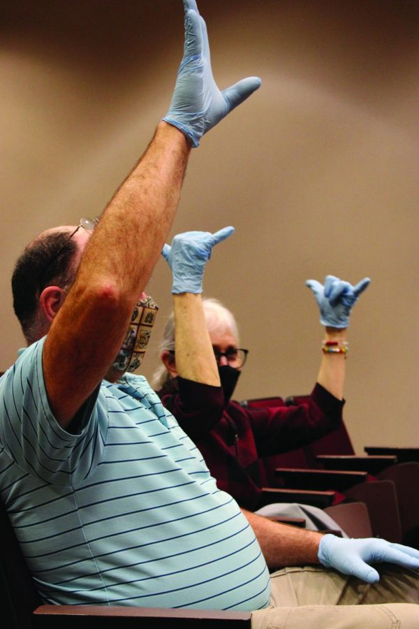 Audience members particpated by demonstrating the job of B-cells.