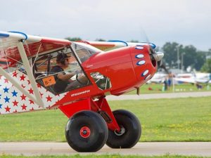 """Trent Palmer's #freedomfox taxiing on P5 before turning into the ditch to stage for the Thursday night STOL competition. #osh18 #STOL #kitfox"" by Micah Maziar is licensed with CC BY-NC-SA 2.0. To view a copy of this license, visit https://creativecommons.org/licenses/by-nc-sa/2.0/"