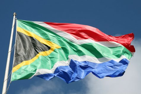 South African flag, Port Elizabeth, Eastern Cape, South Africa by flowcomm is licensed with CC BY 2.0. To view a copy of this license, visit https://creativecommons.org/licenses/by/2.0/